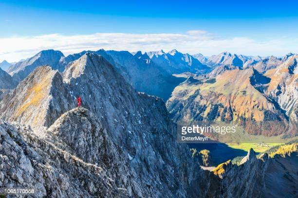 mountaineer on top of  mount lamsenspitze high above nature reserve großer ahornboden, karwendel - alps - karwendel mountains stock pictures, royalty-free photos & images