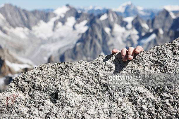 Mountaineer 's hand on summit, close up