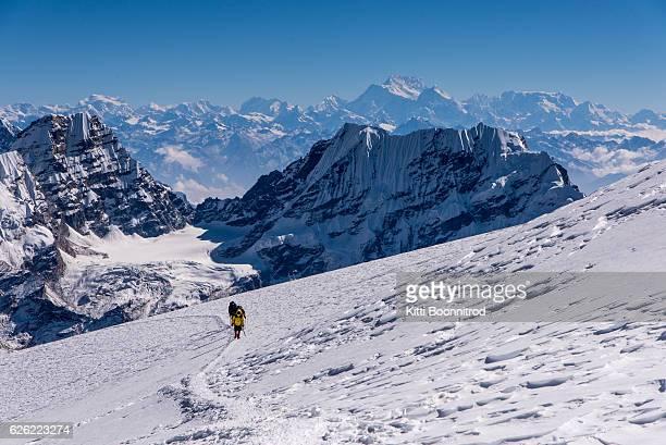 Mountaineer walking up to Mera peak