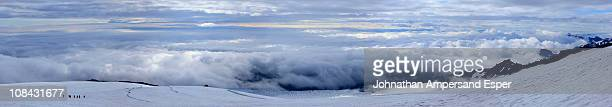 Mountaineering group descending Hvanadalshnukur mountain in Iceland above clouds
