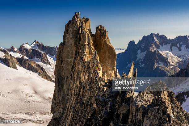 mountaineers climbing aiguille 'entreves in italy - aiguille de midi stock photos and pictures