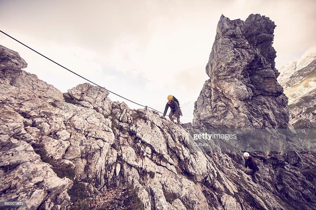 Klettersteig Austria : Mountaineers climbing mountain via ferrata klettersteig low angle