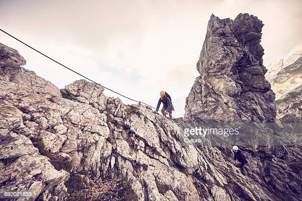 Mountaineers, climbing mountain, via Ferrata, Klettersteig, low angle view, Innsbruck, Tyrol, Austria
