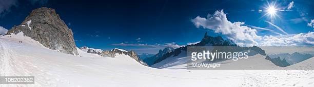 Mountaineers Climbing Snow Covered Ridge