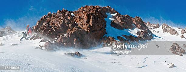 Mountaineers climbing to snowy summit High Atlas Morocco Africa panorama