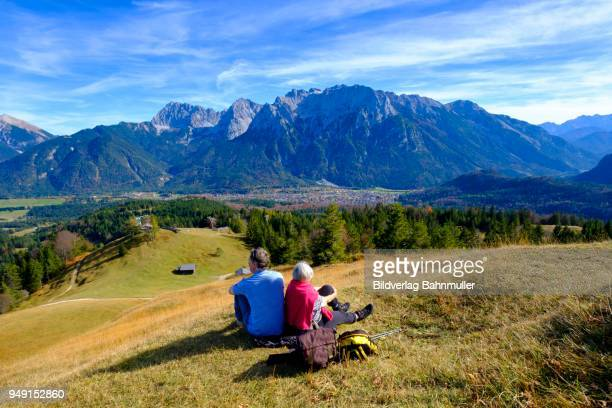 mountaineers, hikers resting at the summit, kranzberg, near mittenwald, werdenfelser land, upper bavaria, bavaria, germany - bavaria stock photos and pictures