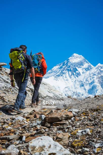 Mountaineers hiking along trail below Mt Everest summit Himalayas Nepal
