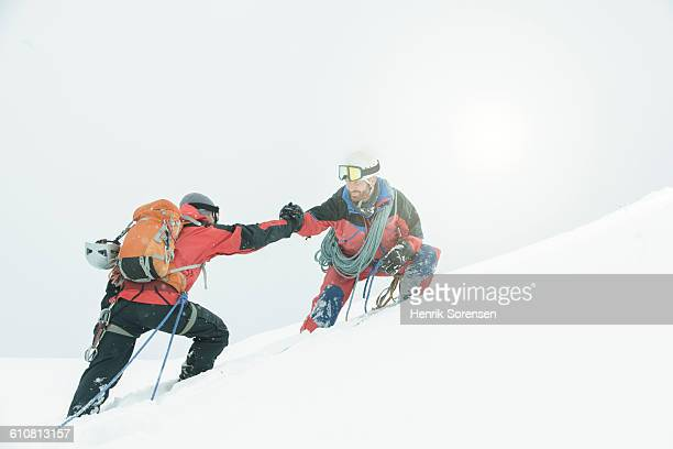 2 mountaineers in the swizz alpes - mountain climbing stock pictures, royalty-free photos & images