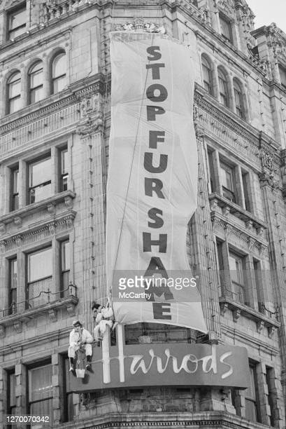 Mountaineers Joe Simpson and John Stevenson of Greenpeace stage a demonstration against the sale of fur at Harrods department store, London, 27th...