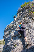 Mountaineers on equipped rockface
