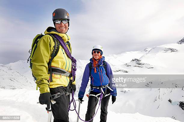 Mountaineers on snow-covered mountain looking at camera smiling, Saas Fee, Switzerland