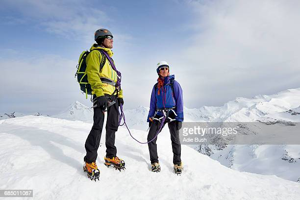 Mountaineers on top of snow-covered mountain looking away, Saas Fee, Switzerland