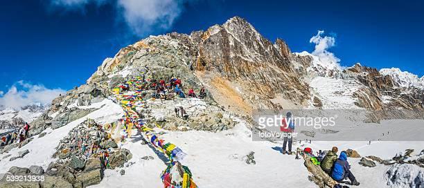 Mountaineers prayer flags Cho La pass Himalaya trekking panorama Nepal