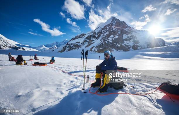 mountaineers resting on denali. - mt mckinley stock photos and pictures
