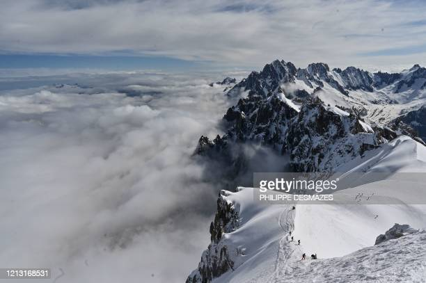 TOPSHOT Mountaineers ski to the 'Vallee Blanche' a glacial valley located in the MontBlanc massif from the 'Aiguille du Midi' peak in Chamonix on May...