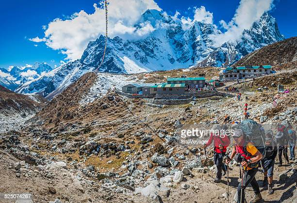 Mountaineers trekking on Everest Base Camp trail Himalayas Nepal