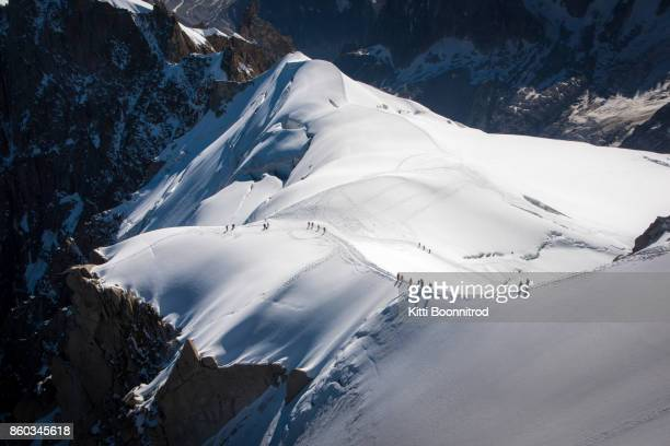 Mountaineers walking down on the ridge of Aiguille du Midi, France