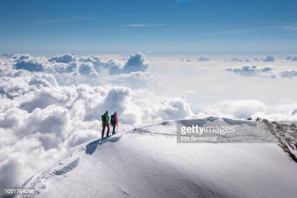 mountaineers walking on the ridge of weissmies, switzerland - mountaineering stock pictures, royalty-free photos & images