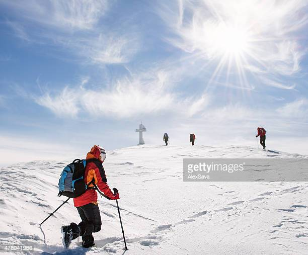 Mountaineers walking up the mountain in winter