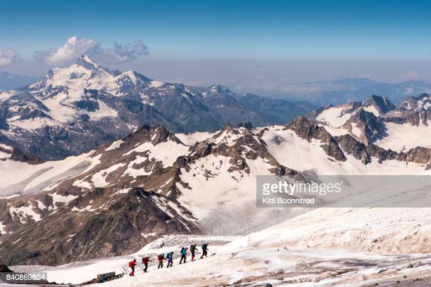 Mountaineers walking up to the summit of Mount Elbrus, Russia