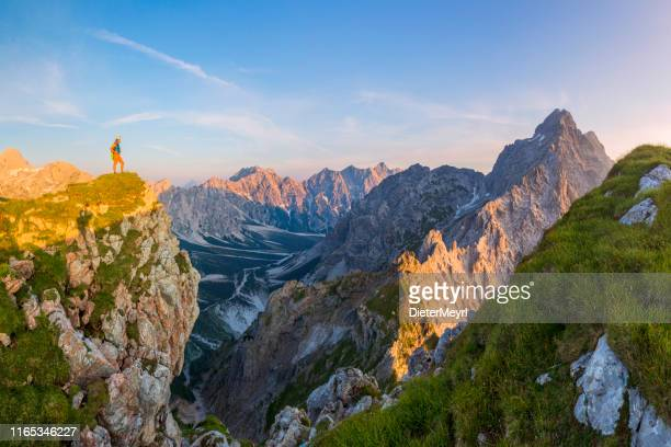 mountainer at glory sunrise with view to watzmann east wall - bavaria stock pictures, royalty-free photos & images