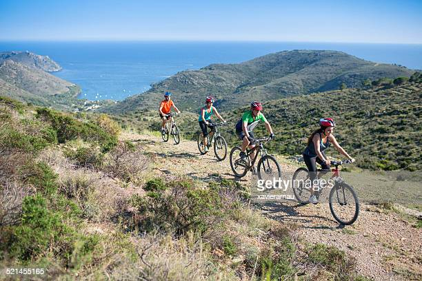 mountaing bike next to the mediterranean - catalonia stock pictures, royalty-free photos & images