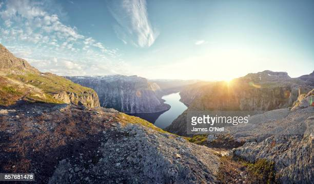 mountainous landscape and fjord at sunset, norway - nature stock pictures, royalty-free photos & images