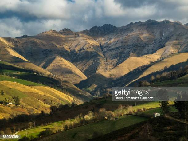 mountainous landscape of the interior of cantabria, with hillsides eroded by fire to obtain pastures, which are illegally burned annually by the ranchers. - social issues stock pictures, royalty-free photos & images