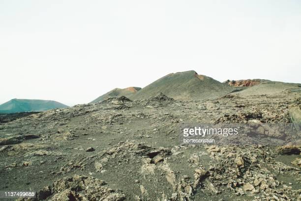 mountains against clear sky - bortes fotografías e imágenes de stock