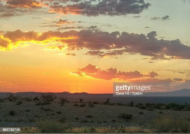 mountains against cloudy sky during sunrise - boulder city stock photos and pictures