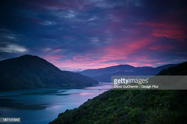 Mountains Along The Coastline Under A Red Sky At Sunset