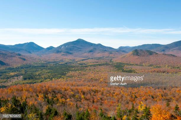 Mountains and forest with colourful autumn foliage, Indian Summer, view from Mount Van Hoevenberg, Lake Placid, Adirondack Mountains, New York, USA