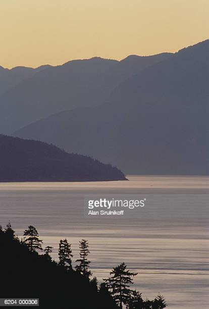 mountains and lake - sirulnikoff stock photos and pictures