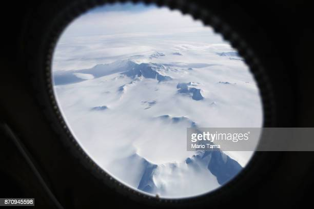 Mountains and land ice are seen from NASA's Operation IceBridge research aircraft in the Antarctic Peninsula region on November 4 above Antarctica...