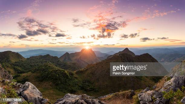 mountains and mist in sunrise time at doi luang chiang dao. - generic location stock pictures, royalty-free photos & images