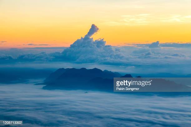 mountains and mist in sunrise time at doi luang chiang dao - holy city park stock pictures, royalty-free photos & images