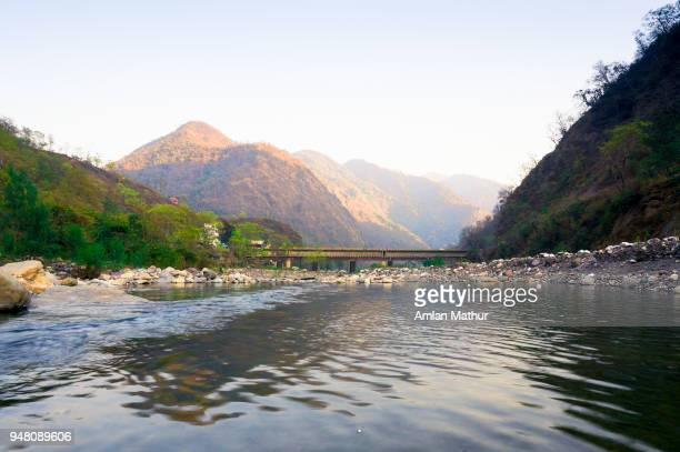 mountains and river shot in haridwar india - haridwar stock pictures, royalty-free photos & images