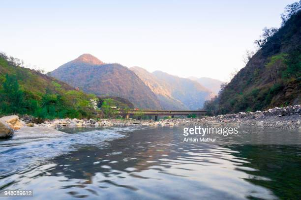 mountains and river shot in haridwar india - ganges river stock pictures, royalty-free photos & images