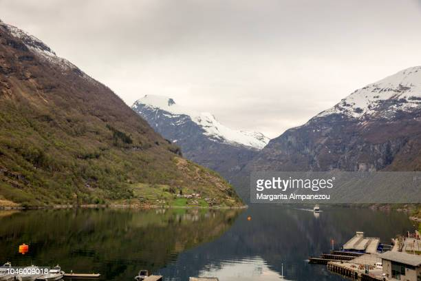 Mountains and their reflection at Geiranger fjord