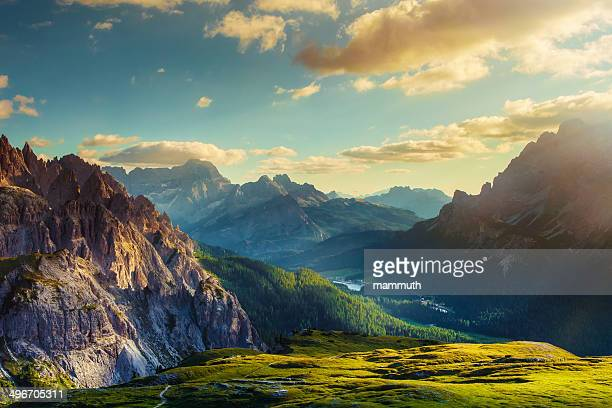mountains and valley at sunset - sunset lake stock photos and pictures
