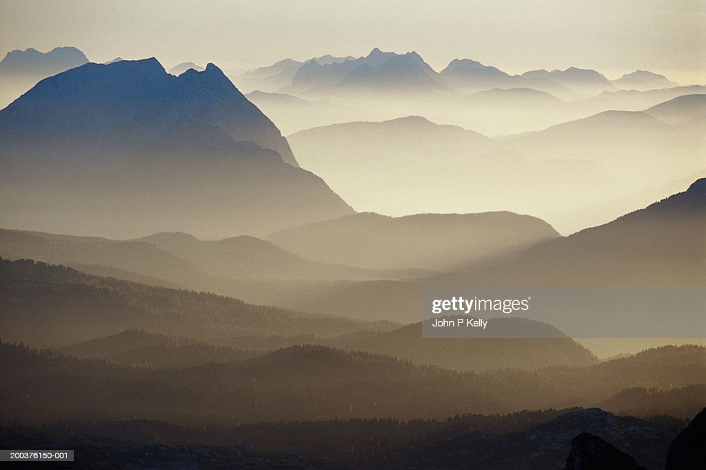 Mountains and valleys in mist : Stock Photo