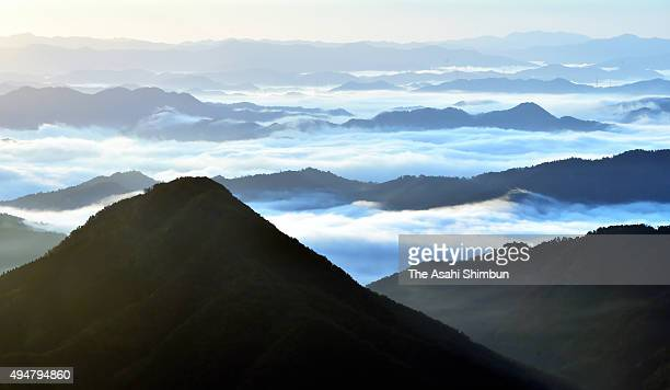 Mountains are blanketed by sea of clouds at Mount Oeyama on October 29 2015 in Fukuchiyama Kyoto Japan
