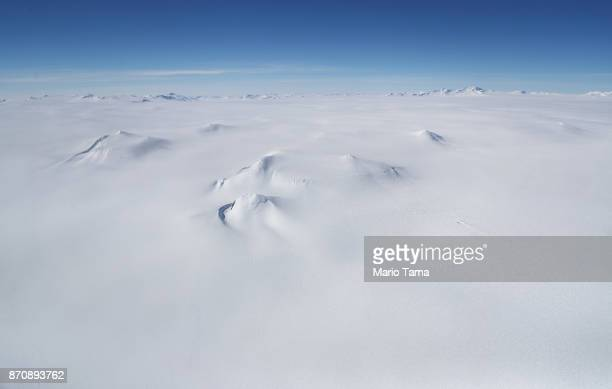 Mountains are mostly covered in ice as seen from NASA's Operation IceBridge research aircraft in the Antarctic Peninsula region on November 3 above...