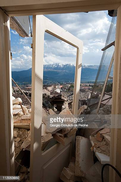Mountains are viewable through the rubble and doorway of a collapsed house in the village of Paganica, two years on from the April 6, 2009 earthquake...