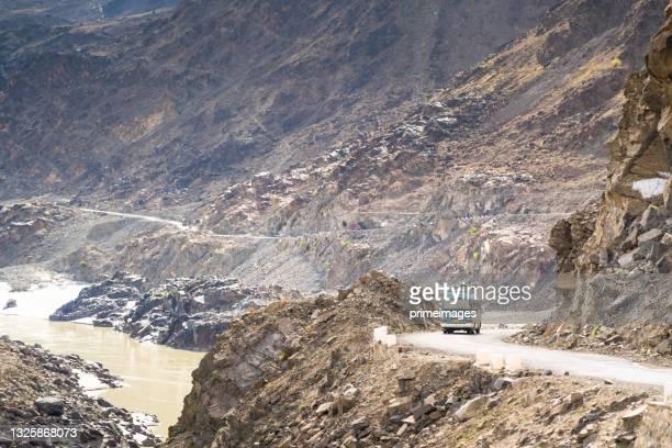 mountains around pasu, karakoram highway with blue van travel to northern pakistan - pakistan stock pictures, royalty-free photos & images