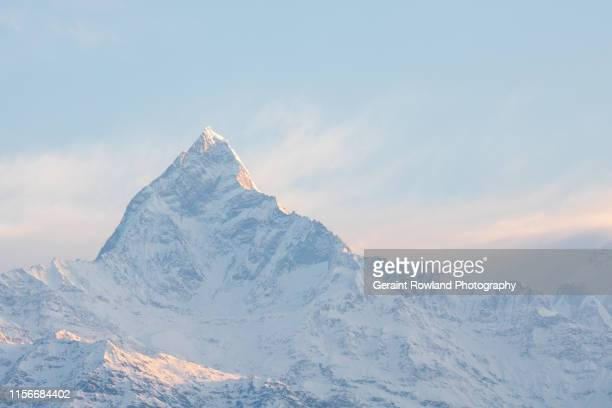 mountains at sunrise, nepal - annapurna south stock photos and pictures
