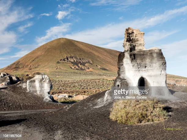 mountains eroded by the climate in the island of lanzarote, canary islands, spain. - arrecife stock photos and pictures