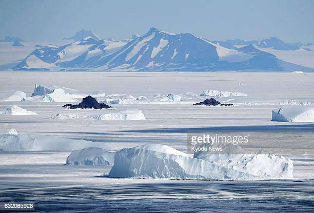 Mountains in Antarctica and ice floating in the Antarctic Sea are seen in this photo taken Dec 17 from a helicopter of Japan's Maritime SelfDefense...