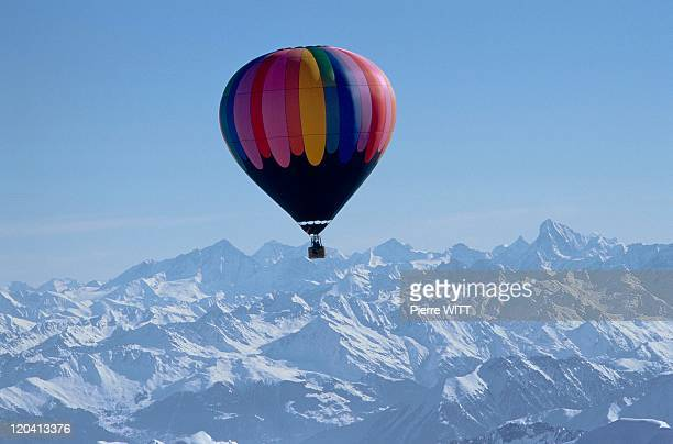 Mountains In Ballooning In France In February 2003 Winter flight in Chablais A hotair balloon at an altitude of 4000m The Valaisian Alps in the...