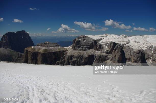 mountains in canazei, italy in winter - カナツェイ ストックフォトと画像